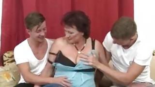 Fat mature sucks and fucks two cocks in threesome image