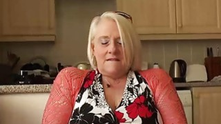 Image: British mature blonde granny Carol fingers her wet pussy