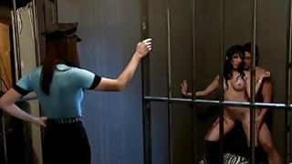 Sexy women foursome sex in the jail cell image
