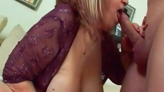 Older brunette woman named Dominika enjoys hard pussy banging with a young hard cock image