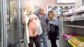 Luna Star fucks her pussy with eggplants in a store image