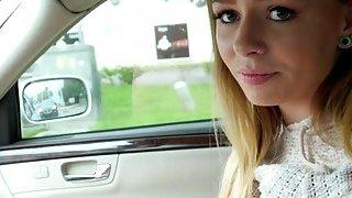 Blonde teen flashing natural tits in car image