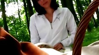 A very hot brunette teen seduces an older man in a forest and sucks his dick image