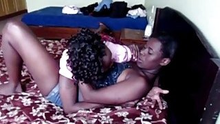 Image: Amateur African lesbians playing_with strap on