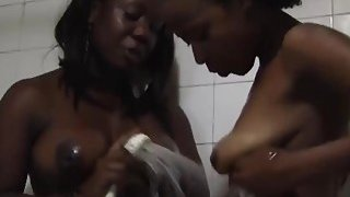 Soapy shower and hot lesbian action with two hot African sluts image