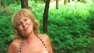 Blonde Granny Stally Enjoys Giving Head Outdoors image
