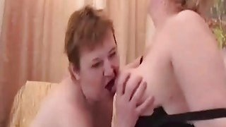 Image: Two lusty mature lesbian sluts please their wet hungry vagina with a sex toy