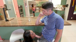 Sarah Banks sucking cock under the counter and her sister_is none the wiser image