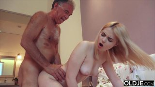 Nympho sucks grandpa_cock has sex with him on her image