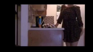 Image: Housewife Arina masturbates in the kitchen