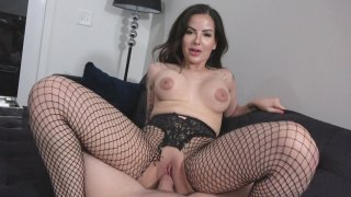 Vivienne Wynter in ripped fishnet pantyhose gets fucked in POV image