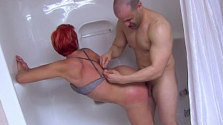 Shower sex with a redhead MILF image
