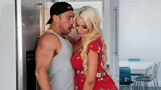 Blonde mom Nicolette Shea is sucking cock_in the kitchen image