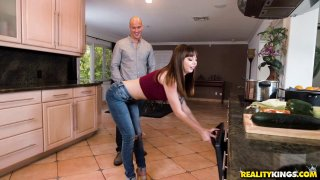 Image: Pretty brunette teenie gives an unforgettable blowjob in the kitchen