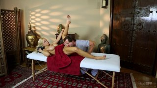 Big breasted MILF gets fucked and jizzed on massage table image