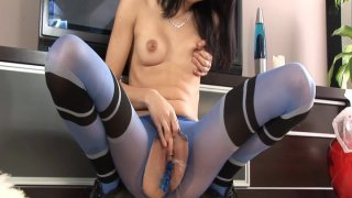 Image: Young and horny brunette dildoing her pussy in nylon