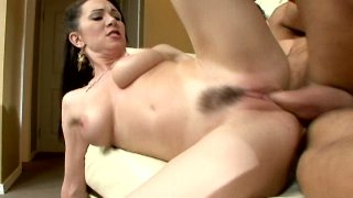 Hussy brunette Rayveness with her hairy pussy jumping on a cock and getting poked from behind image
