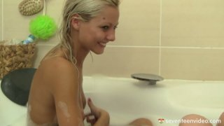 Two hot chicks Sabrina and Nicoleta bathing_together and stroking soapy bodies image