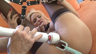 Beautiful blonde Diamond Foxxx chained and stretched with vaginal speculum image