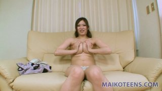 Busty Asian chick Eri Izumi shows her hairy pussy image