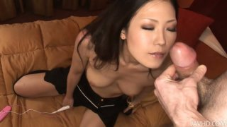 Brunette asian MILF gives blowjob and fucks missionary image