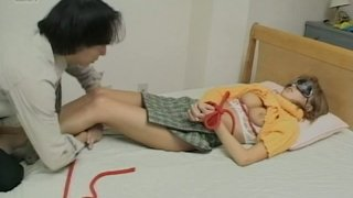 Blindfolded nerdy slut from Japan gets bounded and pussy licked image