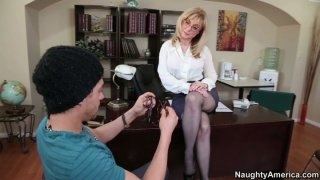 Image: Horny milf Nina Hartley teaches young guy sex tricks