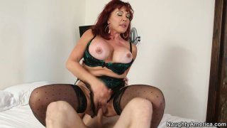 Thick mature redhead Vanessa rides young cock image