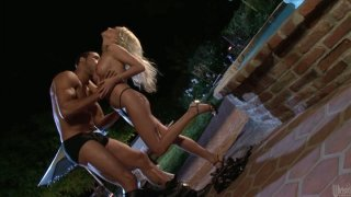 Sweet Diana Doll sucks a cock near the_pool at night image