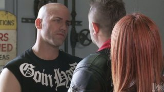 Image: Horny red haired biker Kirsten Price enjoys a hot cunnilingus