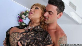 Nasty granny Ava Devine with fake boobs deepthroating and getting_hammered from behind image