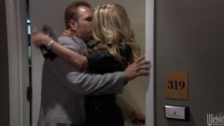 Blond head Jessica Drake wins a cock_in the elevator and sucks it with delight image