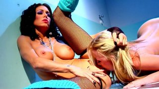 Two trashy bitches Jessica Jaymes and Madison Scott please each other in a dirty lesbian games image