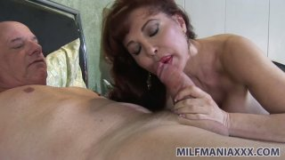 Horny milf Sexy Vanessa gives footjob and blows mature dick in 69 position image