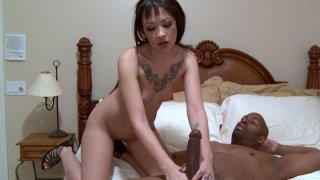 Pale brunette with too small tits Coco Velvet gives a_blowjob to a stiff black cock image