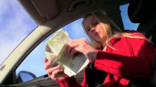 Dirty-minded Lucie sucks a cock in the car for money image