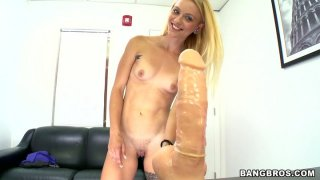 Seductive blonde Cameron Canada poses on a cam and pokes her twat with a fat dildo image
