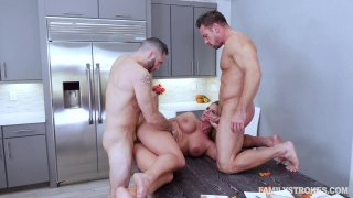 Thick ass milf fucks with two studs in the kitchen image