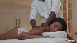 Mandingo fucks beautiful black client Nia Nacci on the massage table image