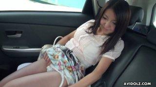 Yummy Japanese chick Mami Sugiyama is masturbating in the back seat image