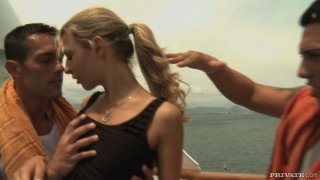 Hot blonde Kristi Lust giving a double blowjob image