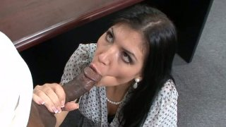Brunette slut Rebeca Linares as a secretary sucking her boss' cock and getting nailed on an office table image