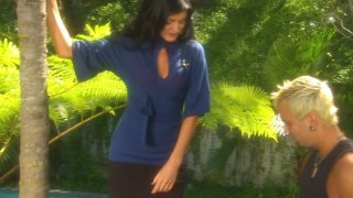 Sultry black haired MILF Lake Russell gives her stud a hot blowjob image