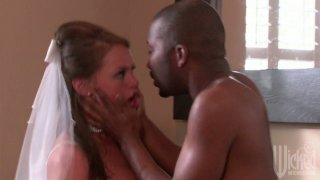 Cheating bride Tori Black blows dick of black man and gives her pussy image