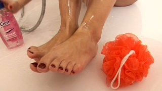 Image: Sweet blonde gal Suzie Carina washes her feet in a hottub