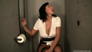 Hungry for cock Alia Janine sucks the dick in a public toilet image