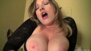 Image: Crummy blondie with droopy boobs Vicky Vixen gives a blowjob in the toilet booth