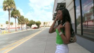 Image: Slim black chick Courtney Foxxx seduces a man in the street