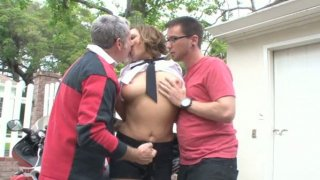Bonerific brunette MILF is getting fucked hard in MMF threesome_outdoor image