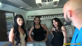 Trio of amateur cuties flash their boobs in the roadside cafe image